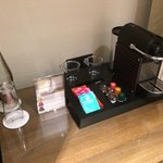 Complimentary still water and Nespresso machine with coffee pods and tea bags.