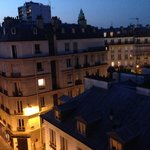 Parisian rooftops - view from top floor by night