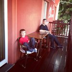 Husband and son relaxing on the balcony
