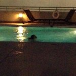 Relaxing at night swimming gym located here too guys were in there it was nice too