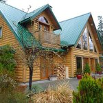 The Lodge, high vaulted ceiling, log construction, amazing interior, see the site.