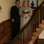 Bride and groom on the gorgeous curved staircase.
