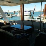 back sitting covered area on boat overlooking Boston