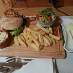 Mexican chicken breast burger and chips, plus cheesecake