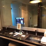Marble bathroom with in-mirror tv