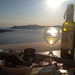 Greek mezza plate and hotel wine