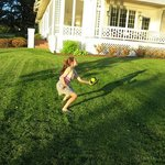 Playing catch with her grandfather.