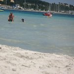 the sea was warm, soft white sand not too hot to walk on. safe for the kids to play very shallow