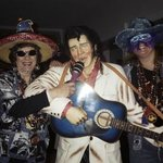 My friend and I with Elvis in the hotel lobby