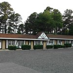 Motel Wing (Left of Office) with Gravel Parking Lot