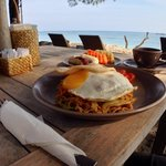 An abundance of delicious breakfast on the beach