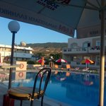 Pool from bar - early evening, mountains in background, self catering apartments to right of pic
