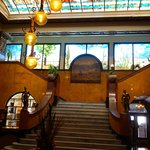Lobby with staircase and stained glass mural
