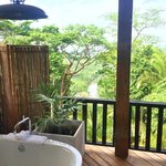 Looking through the floor to ceiling shower picture window to our verandah, soaker tub & Rio Gra