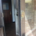 Exterior door missing lock so anyone can enter the building w/o a key! Manager Ann said I was ly