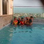 Lalit family in hotel pool