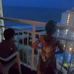 Enjoying the night view from our Ocean View room balcony!