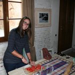 'La mia moglie' making some bruschetta in our kitchenette