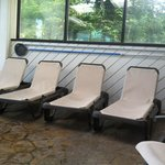 Lounge chairs near pool; other upright chairs and tables not pictured.  Lots of seating