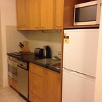 Kitchen appliances clean and relatively new, basic fit out utensils wise but serviceable for sho