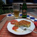 A nice snack with homemade cheese pie and a beer