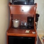 Coffee maker, fridge, and microwave.