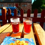 "local pint from the beer garden with the accommodation behind - ""Butcombe' Ales - made us laugh!"