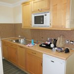 Kitchenette with dishwasher, fridge and microwave