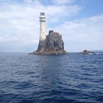 fastnet lighthouse cape clear in background at right