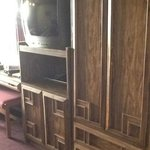 the tv and cabinets
