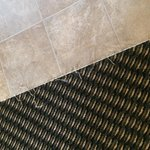 Frayed carpet in whirlpool suite