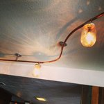 mason jar lights above bar