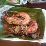 Giant prawns served on banana leaves