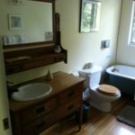 A period piece bathroom with sink set in old wooden dresser