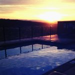 Two of our favorite things: St. George summer sunrises and our warm pool and hot tub!