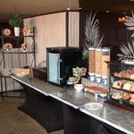 Roaring Start Breakfast - mixed fruit (left), milk and yogurts (cabinet), cereal, and breads