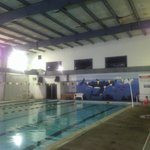 Sketchy, nasty indoor pool. Note the ceiling of this decrepit warehouse...
