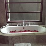 Bathtub covered with rose petals <3