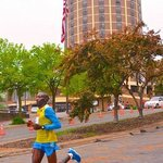 Ondoro passes by Radisson on way to winning marathon in record time