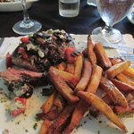 Steak with crumbled blue cheese, tomatoes, herbs