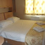 Double bedroom made up with towels provided