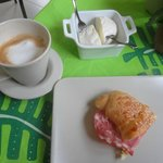 Paper thin Italian ham with cheese in a fresh croissant - half eaten! and Fresh local cheese