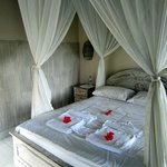 Four poster bed with mosquito net.