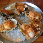 Grilled oysters with chili butter sauce.