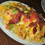 Chloe's Fries - Homefries Smothered in Ranch, Cheeses, Bacon, Diced Tomato, Scallions.