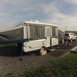 Picture of our Pop-up camper, and as you can see..power lines, but no trees.