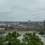 View of the roof terrace garden and beyond from our 8th floor room.  The grey building on the ri