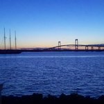 Sunset view of Newport Bridge from outdoor bar & restaurant.