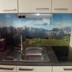 Small but very nice kitchen!! Loved the scenery behind the sink.