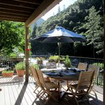 Deck for dining and chatting along the Merced River